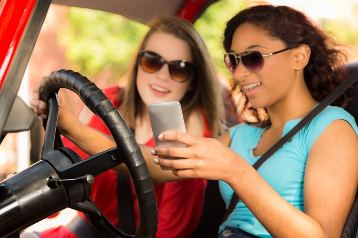 Teens Looking At Phones When Driving